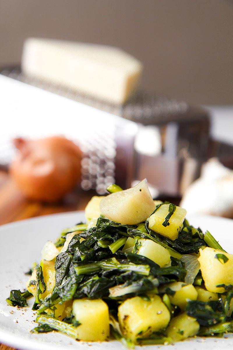 STIR FRIED DANDELIONS AND POTATOES with Pecorino Romano cheese