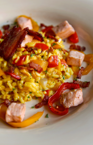 salmon risotto with bell peppers, bacon and saffron