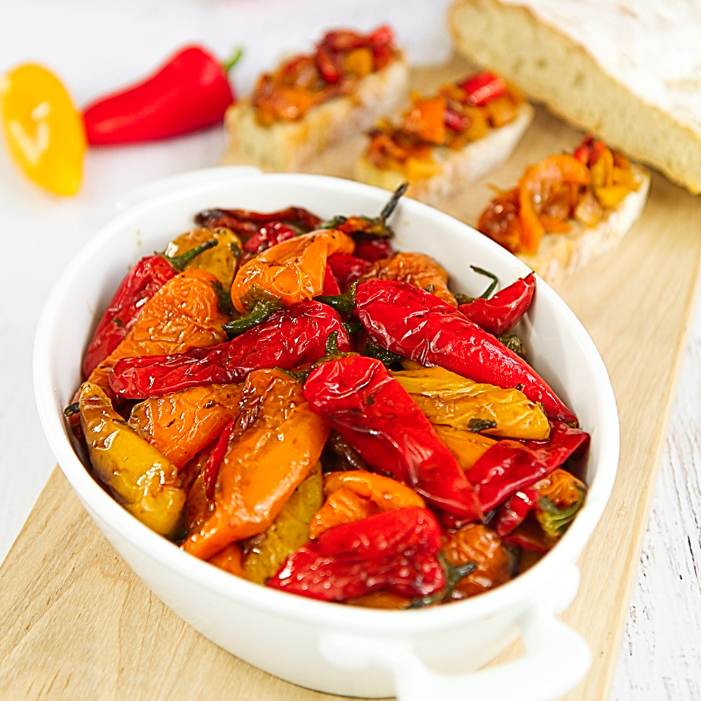 PAN FRIED SWEET MINI PEPPERS with basil leaves and balsamic vinegar