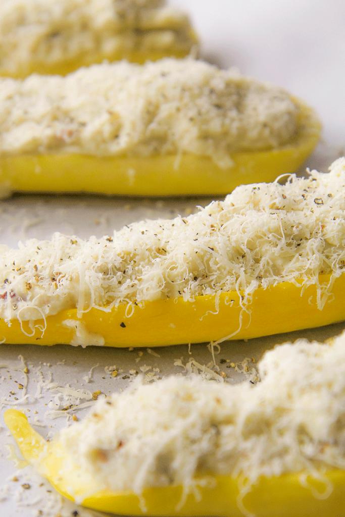 Stuffed yellow summer squash with cauliflower dip and crispy bacon