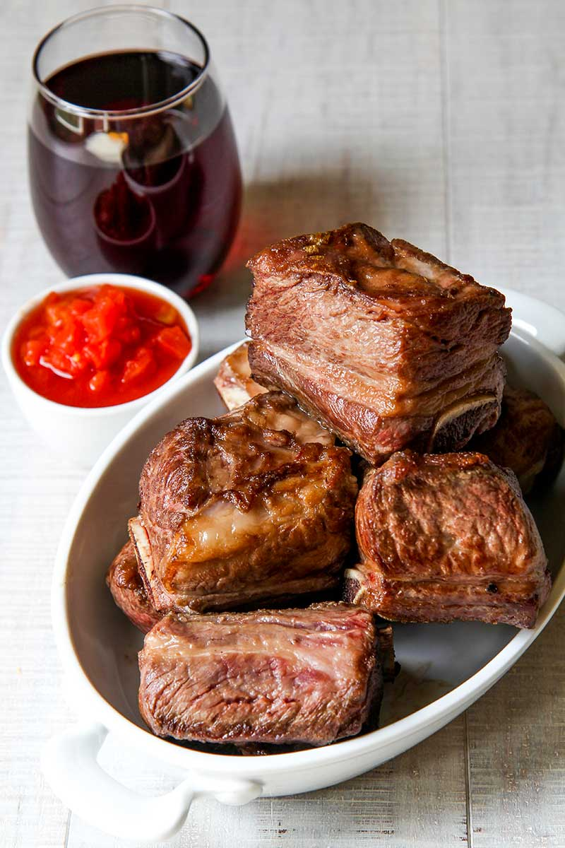 BEEF SHORT RIBS braised with red wine and fresh tomatoes