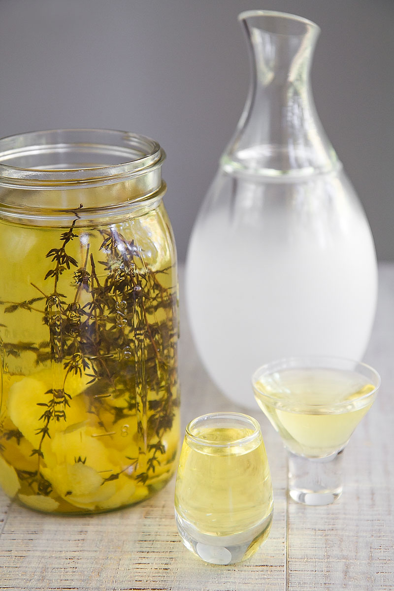 INFUSED SAKE with lemon peels and fresh thyme