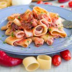 CALAMARATA PASTA WITH SQUID SAUCE: traditional Neapolitan recipe