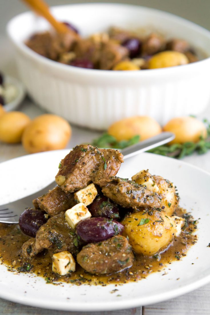 GREEK LAMB STEW with salmoriglio marinade, olives and feta cheese